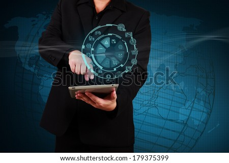 Businessman showing tablet with icon application on virtual screen. Concept of online business. - stock photo