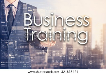 Businessman showing text by his hand: Business Training - stock photo