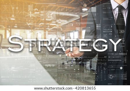 Businessman showing text by his hand: Strategy - stock photo