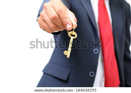 businessman showing the key to success - stock photo