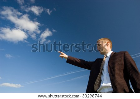Businessman showing the way to the future - stock photo