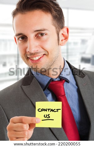 Businessman showing the words Contact - stock photo