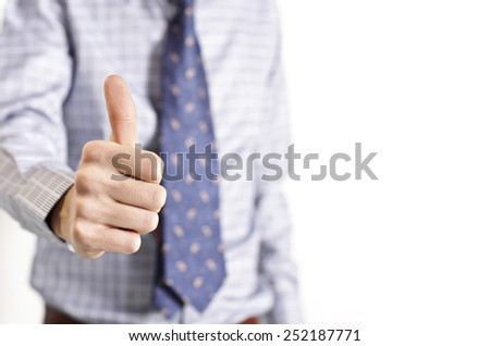Businessman showing thumb up gesture - stock photo