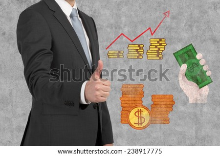 businessman showing thumbs up sign and drawing money