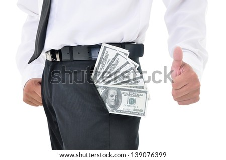 Businessman showing thumbs up with American dollars in his pants pocket, isolated on white background