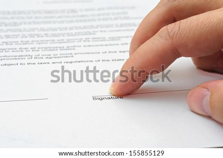 businessman showing to sign agreement - stock photo