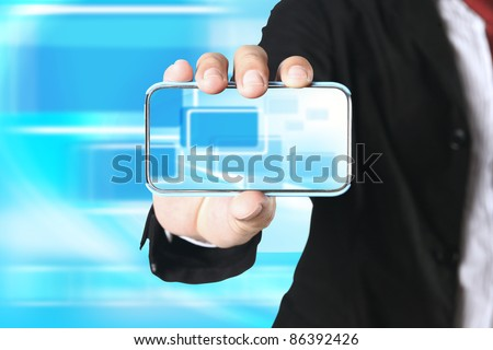 Businessman showing  touch phone on blue background - stock photo