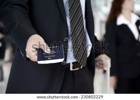 Businessman showing U.S. passport - business trip, check in , boarding & airport immigration concept - stock photo