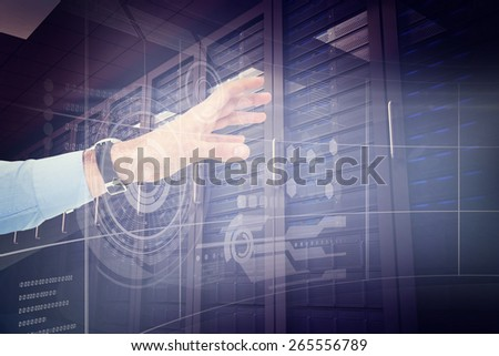 Businessman showing with his hand against digitally generated server room with towers - stock photo