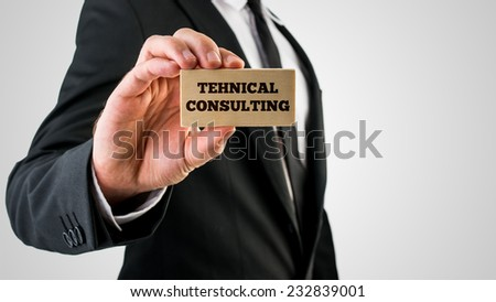 Businessman Showing Wooden Sign with Technical consulting Texts. - stock photo