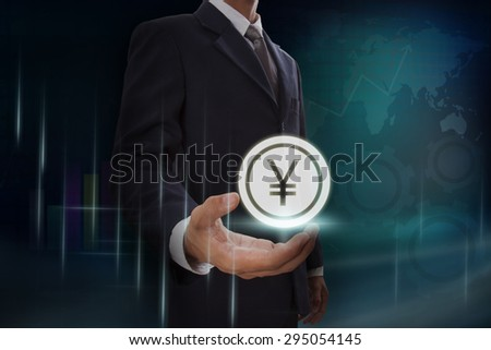 Businessman showing yen sign on screen. business concept - stock photo