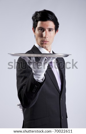 businessman showing you the solution - stock photo