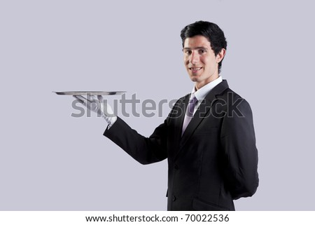 businessman showing you the solution (copy space over the tray) - stock photo