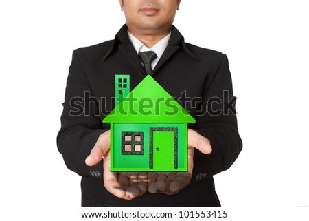 businessman shows a green house