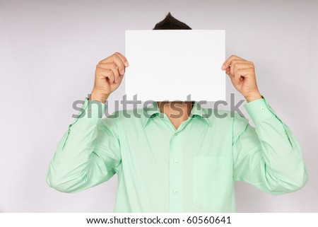 Businessman shows paper before a head. There you can write a text - stock photo