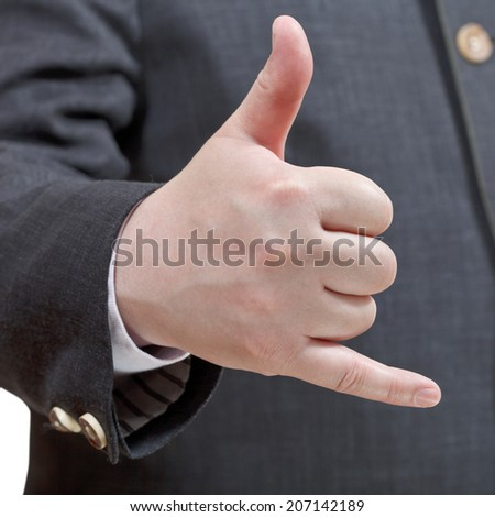 businessman shows phone call sign - hand gesture isolated on white background - stock photo