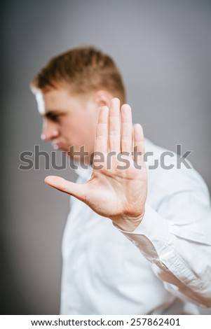 Businessman shows stop gesture - stock photo