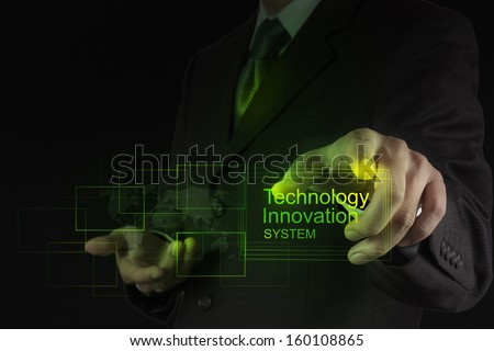 businessman shows technology innovation system as concept - stock photo