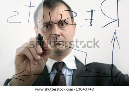 businessman shows the diagram of incomes - stock photo