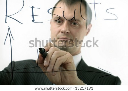 businessman shows the progress of incomes, isolated - stock photo