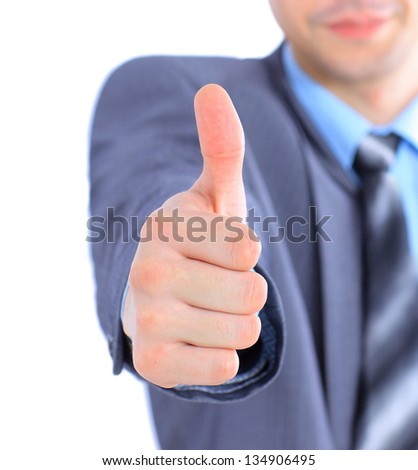 Businessman shows the thumbs up.