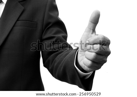 businessman shows thumbs up isolated on white black and white version - stock photo
