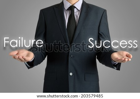 businessman shows two possibilities failure or success - stock photo