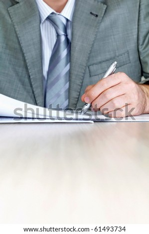Businessman signing a contract - stock photo