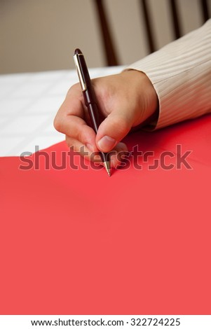 Businessman signing a document - stock photo