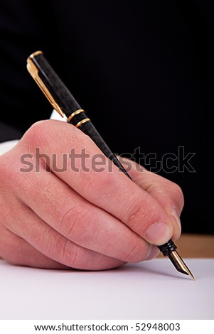 businessman signing a document  with a fountain pen isolated on a white background. Studio shot - stock photo