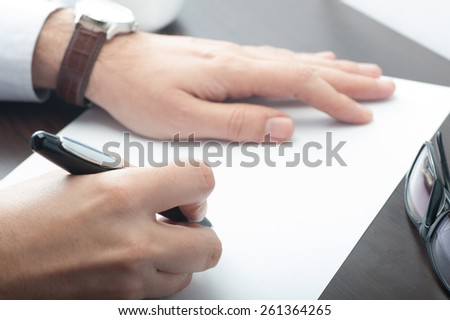 Businessman signing blank document at the office