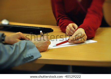 Businessman signing contract with bank clerk help - stock photo