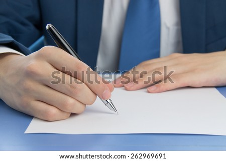 Businessman signing documents in the office