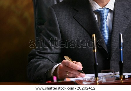 businessman signs agreement - stock photo