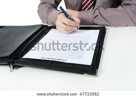Businessman signs contract. Isolated on white background - stock photo