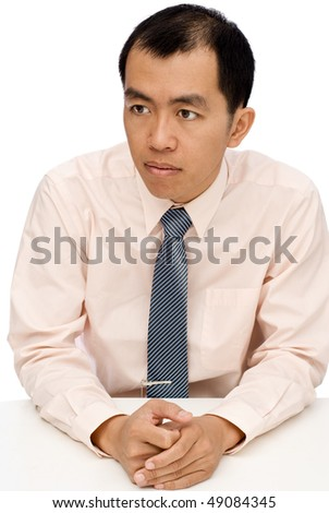 Businessman sit and watch, put hands on white table.
