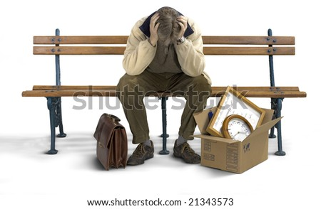 Businessman siting on a bench looking depressed with his stuff packed in a box. - stock photo