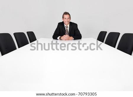 Businessman sitting alone - stock photo