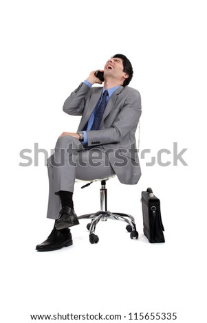 Businessman sitting and laughing - stock photo