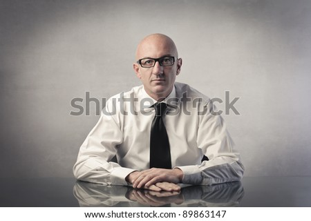 Businessman sitting at a desk - stock photo