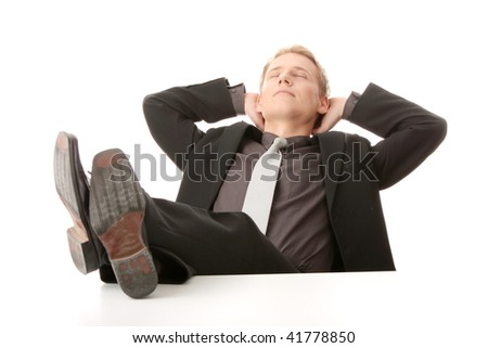 Businessman sitting at desk, isolated - stock photo
