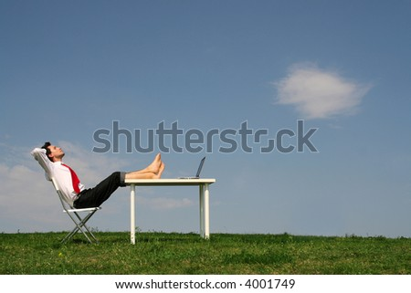 Businessman sitting at desk, outdoors - stock photo
