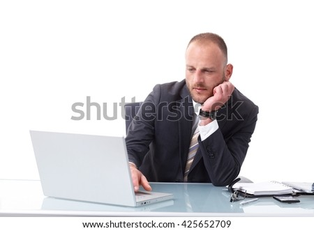 Businessman sitting at desk over white background, working with laptop computer, busy. - stock photo
