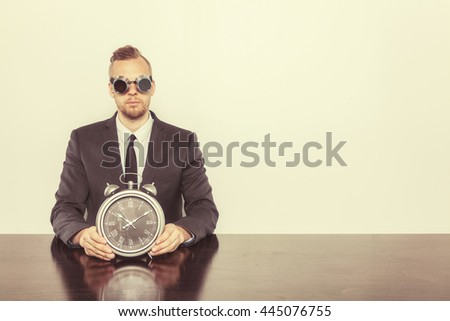 Businessman sitting at office desk - stock photo