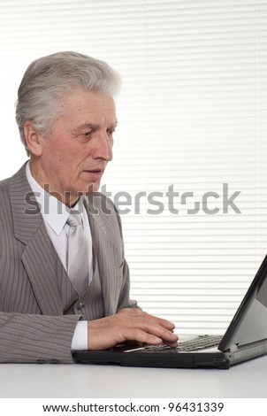 Businessman sitting at the computer on a lght