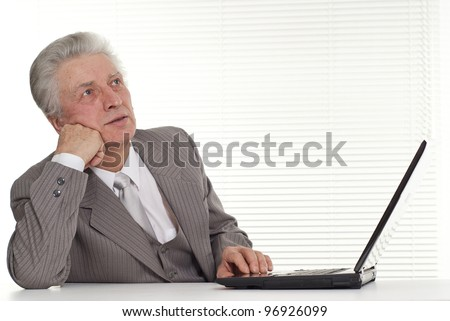 Businessman sitting at the computer on a light background