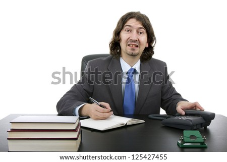 Businessman sitting at the desk, Isolated on white - stock photo
