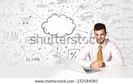 Businessman sitting at white table with hand drawn business concept background - stock photo