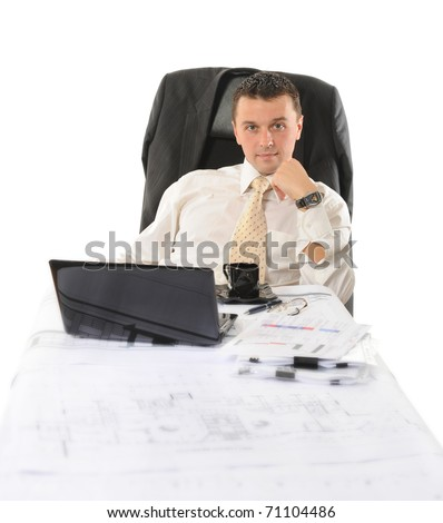 Businessman sitting before a computer. Isolated on white background - stock photo