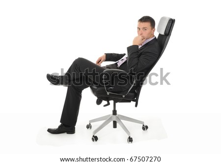 Businessman sitting in a chair in a bright office. Isolated on white background